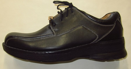 Image of a Docker shoe with a shoe  lift for a person with a leg length discrepancy.