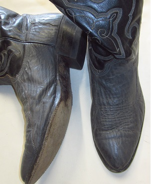 Before picture of western boots with original leather soles.
